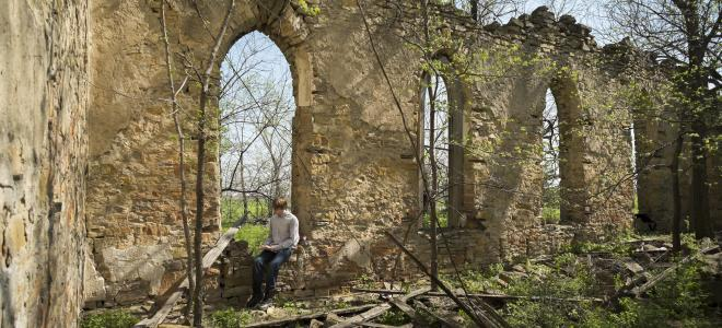 Undergraduate Paul Thomas conducts research in archaeology at a church in Franklin County, Kansas